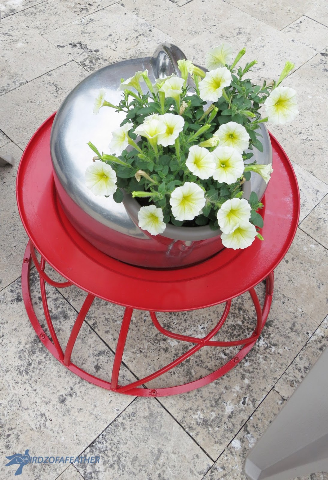 Reusing metal fire pit into table