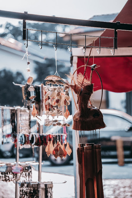 Ethnic accessories on display at an outdoors jewelry fair.