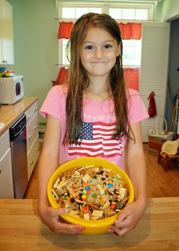 Tessa with her completed trail mix. She was very proud of her work.