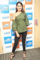 Pragya Jaiswal in a single Sleeves Off Shoulder Green Top Black Leggings promoting JJN Movie at Radio City 10.08.2017 119.JPG