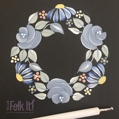 After adding your larger elements, fill any gaps with smaller items such as Rosebuds, dot flowers or comma strokes