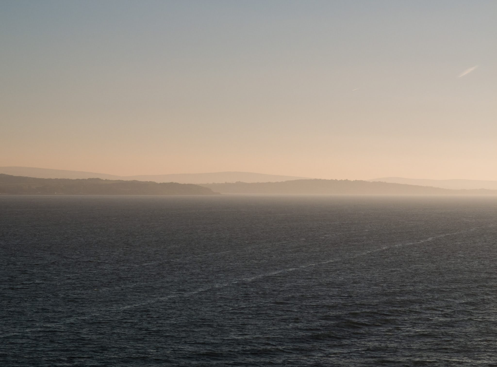 Sailing from Southampton across the English Channel at golden hour.