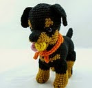 http://www.ravelry.com/patterns/library/rottweiler-puppy-accessories