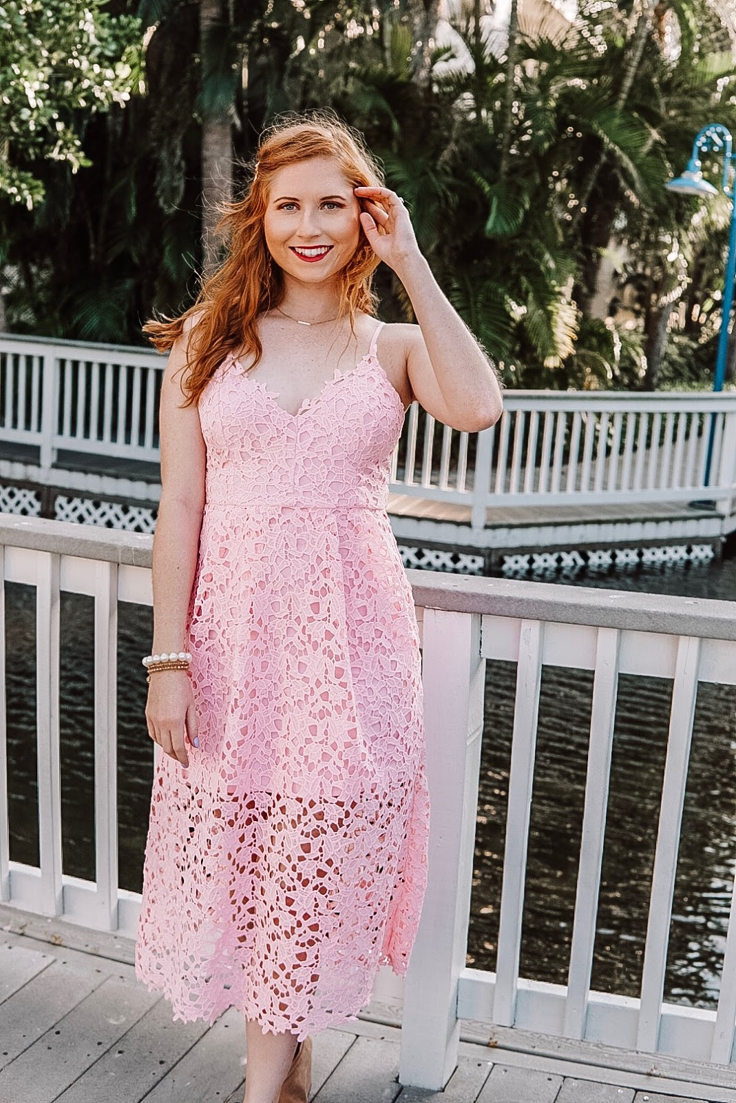 affordable by amanda blogger amanda burrows is wearing a rose astr the label lace midi dress from nordstrom for under $100