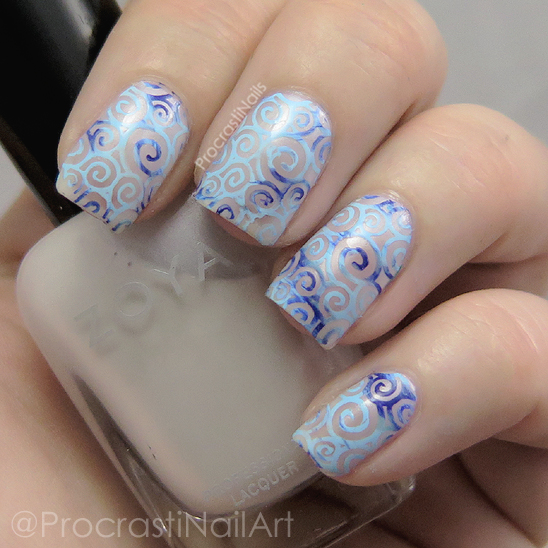 Swirly nail art stamping gradient with blue and white