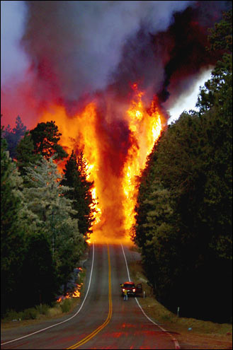 Picture shows the Old Fire jumping Highway 18
