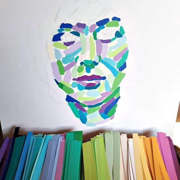 in-progress torn paper background of female portrait art