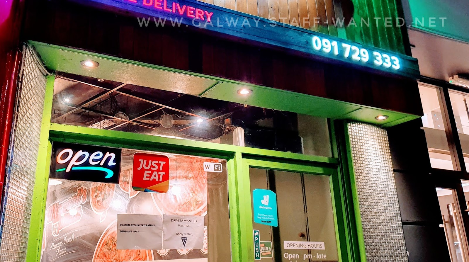 shopfront of mizzoni pizza store galway - open in the evenings only - phone number 091729333