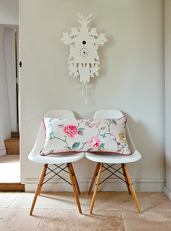 white eames chairs! I love the floral material used on that cushion. The cuckoo clock is fabulous! Fill your home with Clarke and Clarke are fab