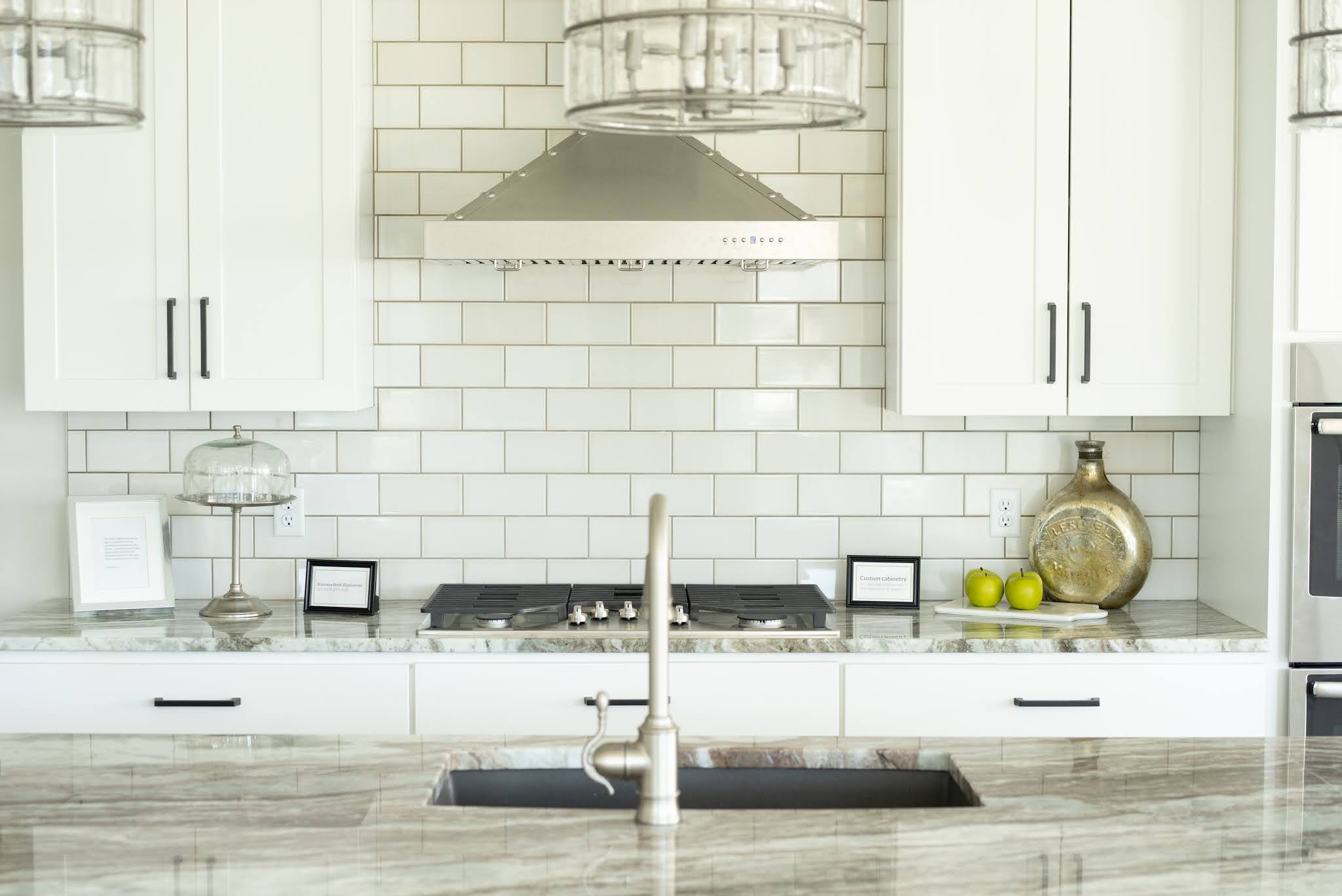 A tile backsplash is one way to add rhythm and repetition