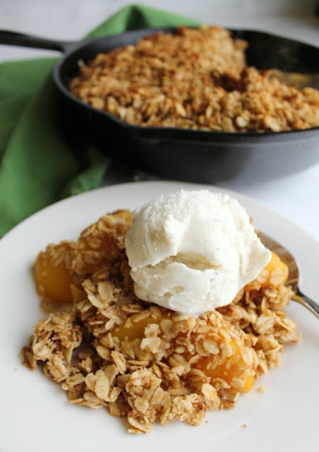 pan of peach crisp with some served a la mode in front of it