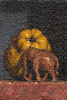 Still life oil painting of a small carved wooden elephant beside a quince.