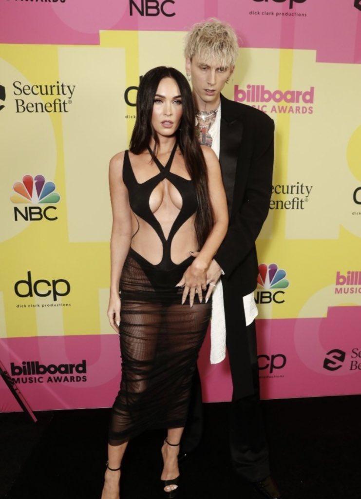 Megan Fox Wears Ultra-Revealing Cutout Gown, Kisses Machine Gun Kelly on the 2021 BBMAs Red Carpet