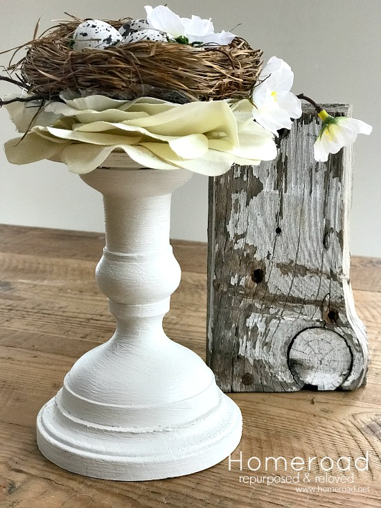 Birds nest made on a flower and a candlestick for Spring