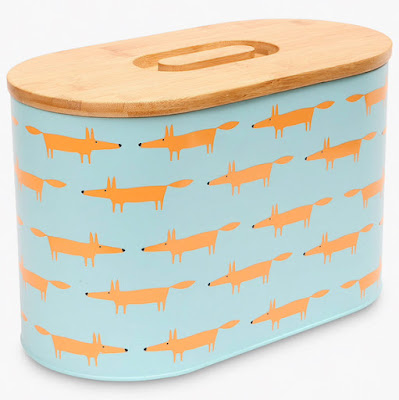 blue bread bin covered with orange foxes