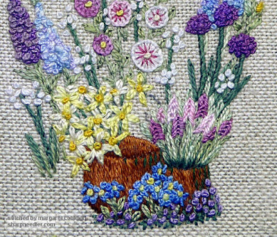 Embroiderd pink flowers in small pot on Lorna Bateman's scissors keeper design