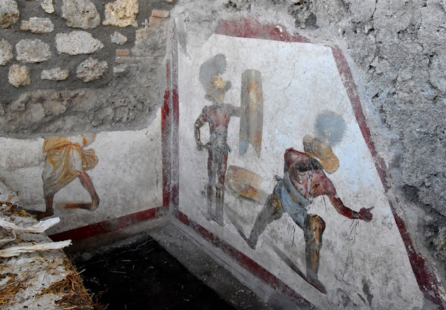 Vivid gladiator fresco discovered at Pompeii