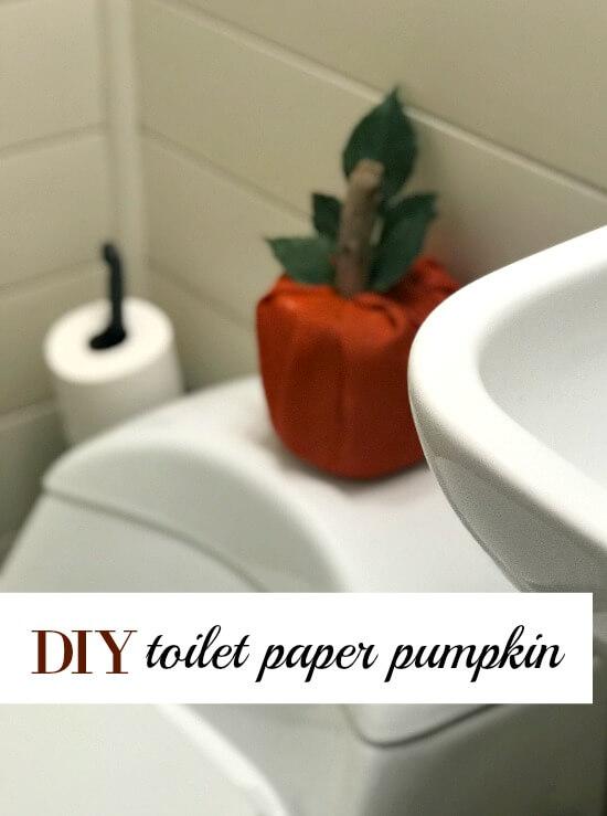 Orange burlap pumpkin on toilet with words.