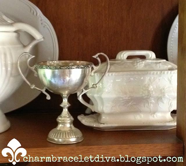 silver loving cup white porcelain lidded gravy boat
