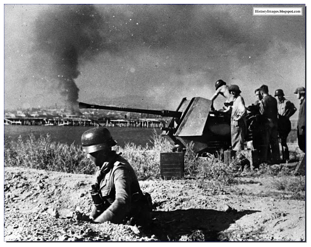 German soldiers adjust their Flak 36 anti-aircraft gun at Novorossiysk Russia. September 1942