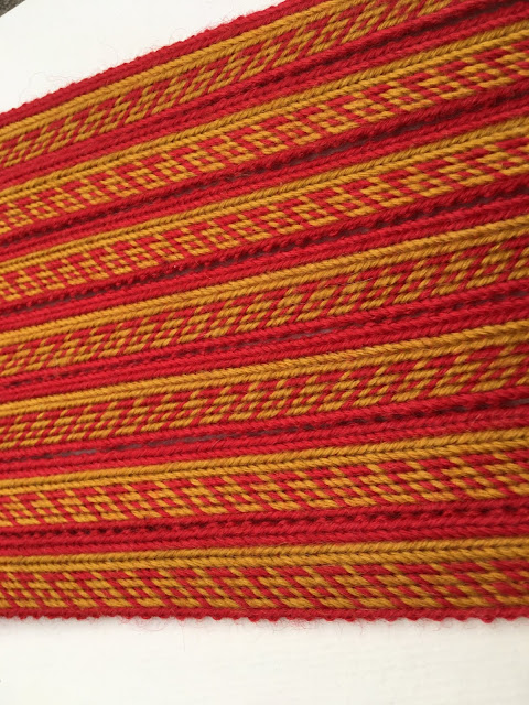 A photograph of a tablet woven band made using the pattern above
