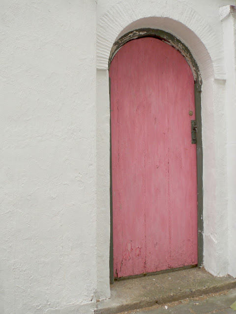 Rustic bright pink door in London - found on Hello Lovely Studio