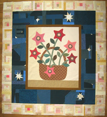 Gwennie-Inspired Medallion quilt with log cabin border