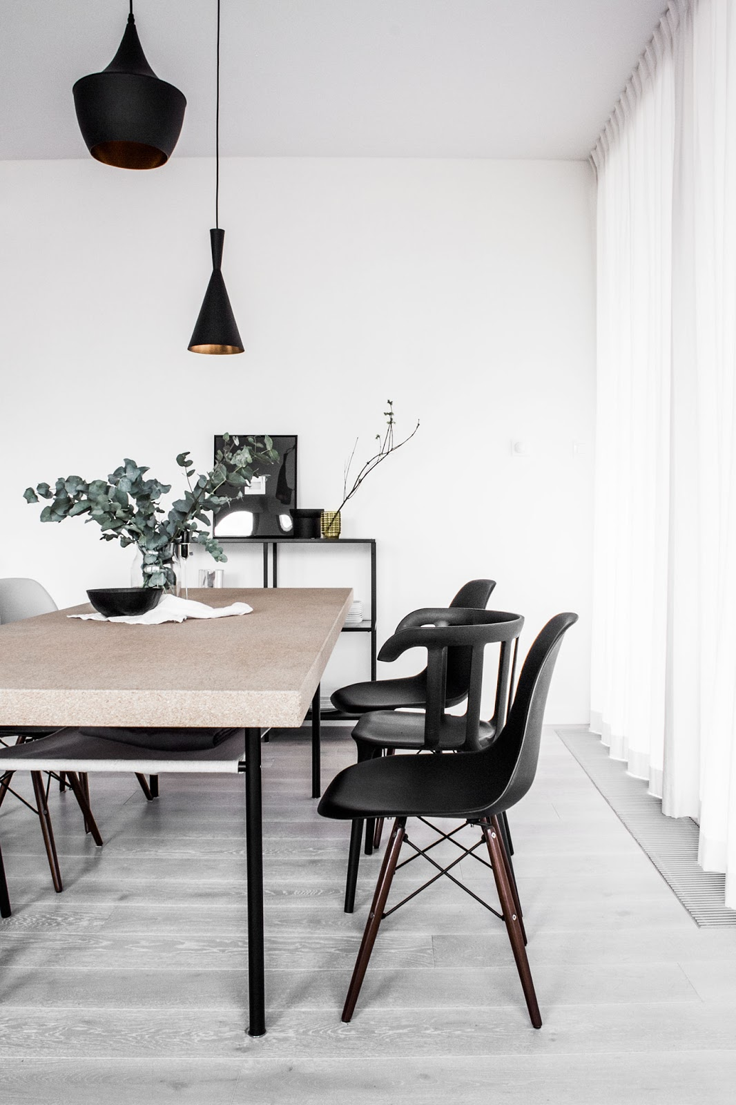 cork dining table, tom dixon lamps, black eames chair,  nordic interior