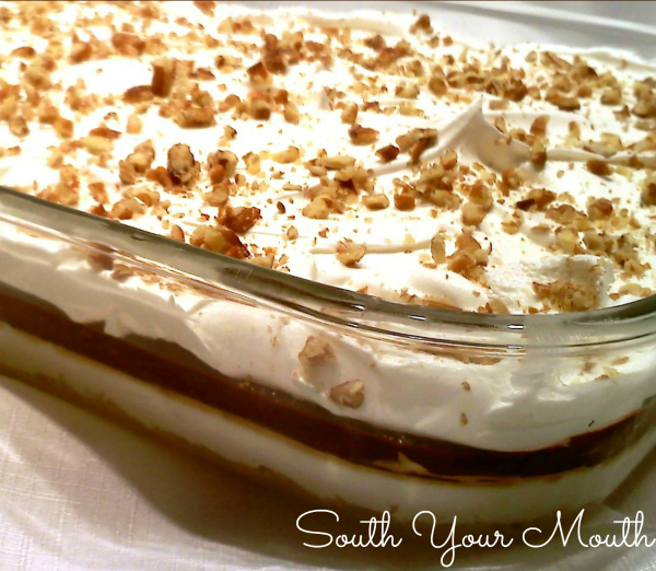 Chocolate Delight! Layered dessert with chocolate pudding, cream cheese and cool whip on top of a pecan shortbread crust. Also called Better Than Sex Cake, Robert Redford Pie and 4-Layer Delight!