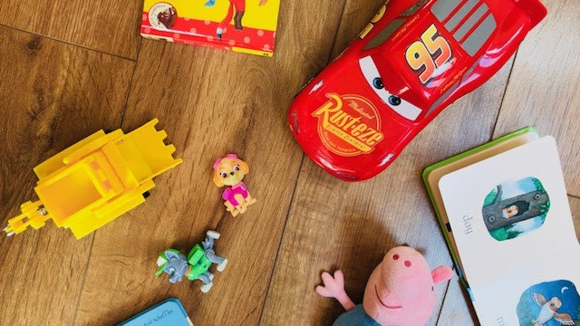 Wooden floor scattered with toys