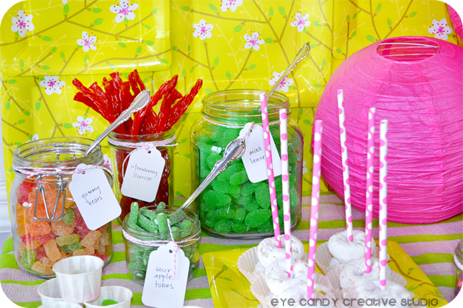 setting up a candy buffet, mini donuts, candy, pink lantern