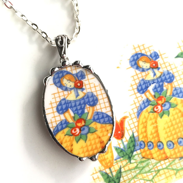 Pretty petit point girl in bonnet china pendant from Dishfunctional Designs