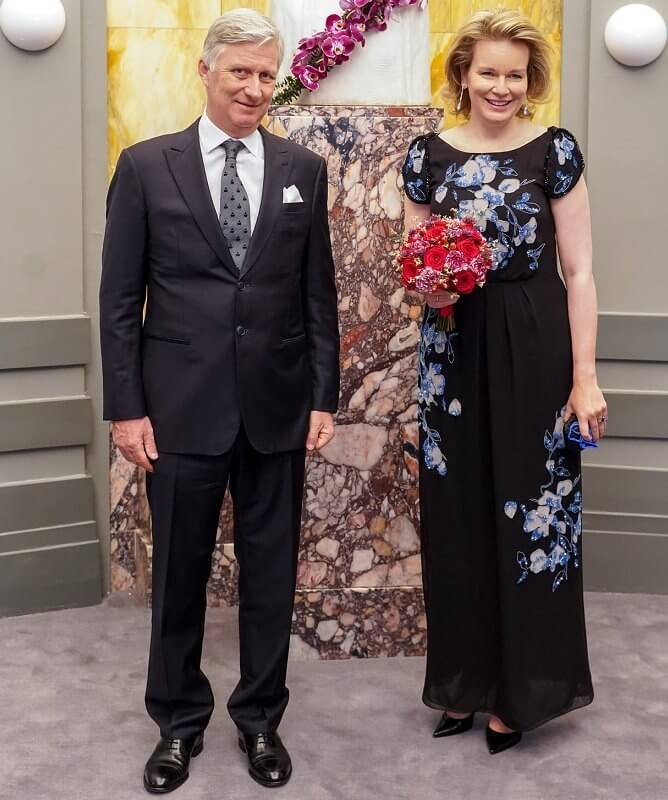 Queen Mathilde wore a floral embroidered black dress drom Dries Van Noten. Emporio Armani floral-embroidered dress