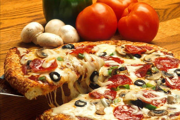 Image: Delicious pizza slice, by PublicDomainImages on Pixabay