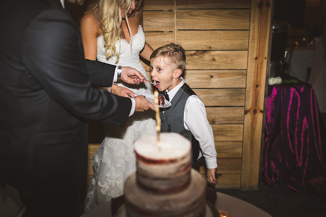 bride and groom with cake and child