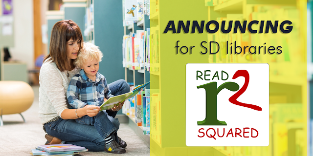 READsquared for South Dakota Libraries. Mom and young boy with open book
