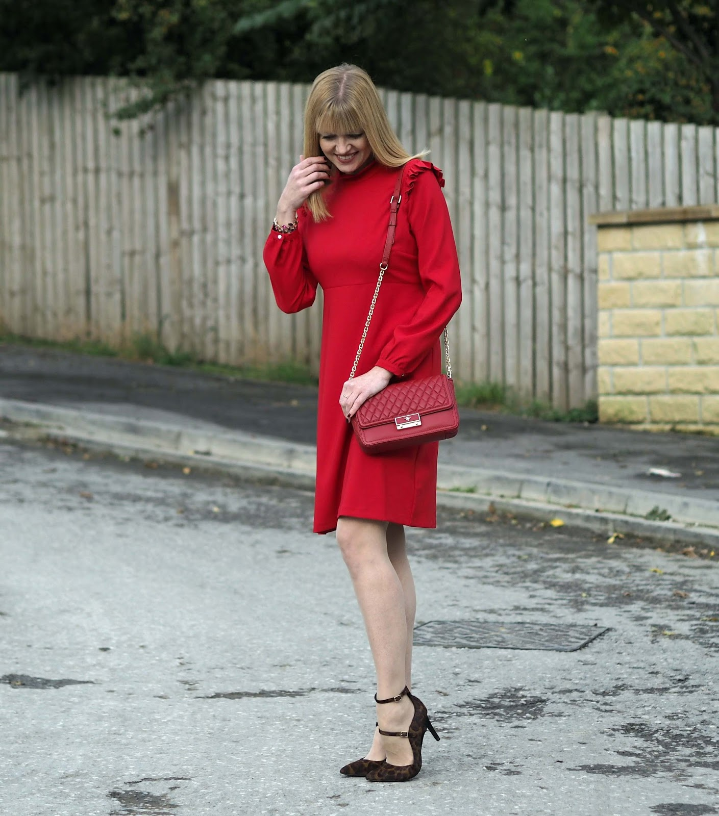 Red ruffle dress with Eternal collection red, purple statement gemstone bracelet
