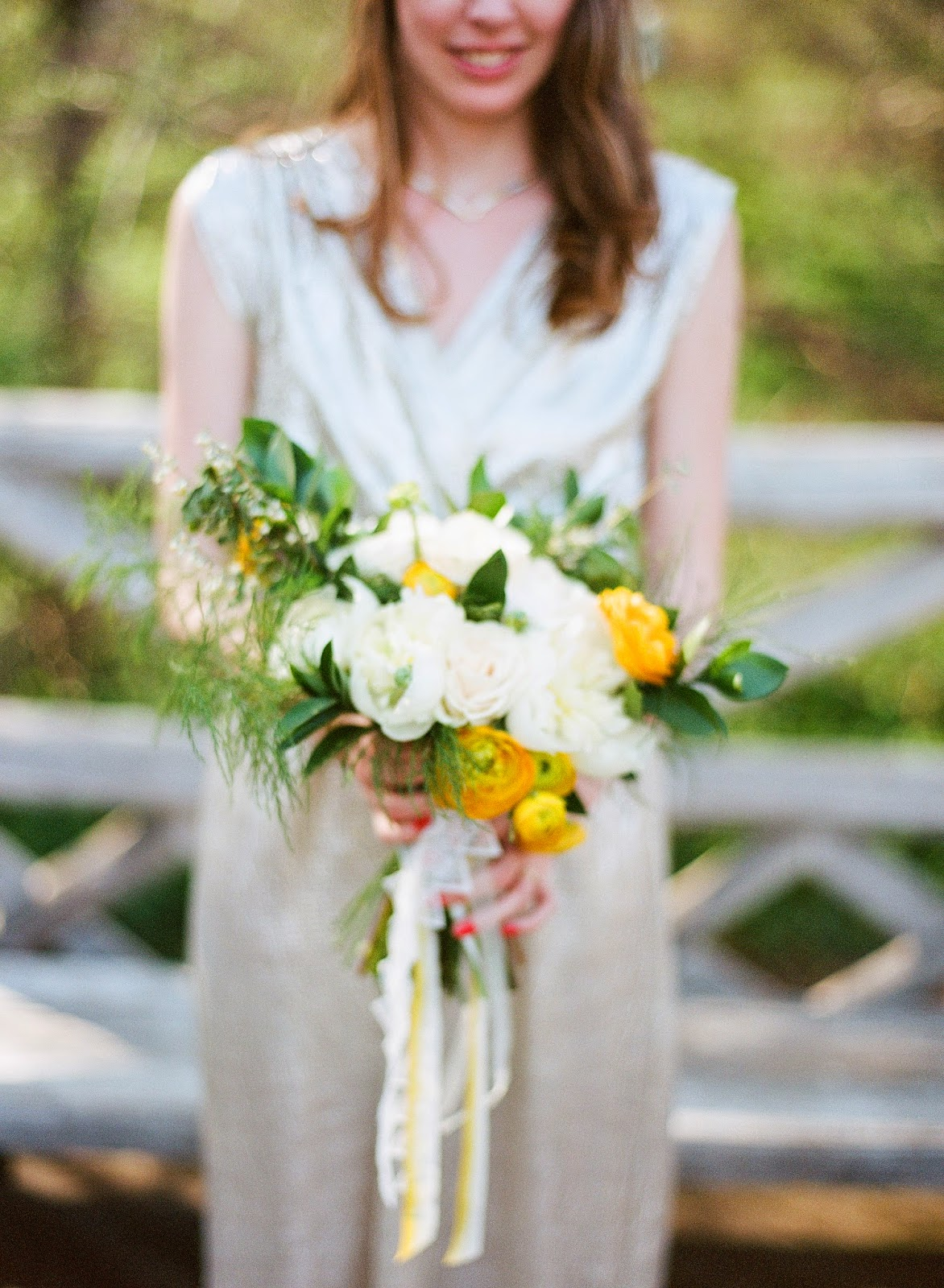yellow ranunculus and white peony spring bouquet tied with hand-dyed silk and vintage ribbon for a brooklyn, new york bride