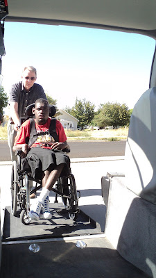 Don and Isaac demonstrating their adapted van.