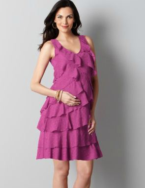 2480c6f89ff10 We crafted this fabulously feminine dress with a bevy of ruffles, then  added a clip dot finish for fun texture and shimmer. V-neck. Sleeveless.