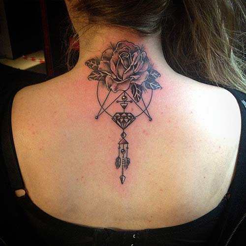 jewelry and rose tattoo on back elmas ve gül dövmesi