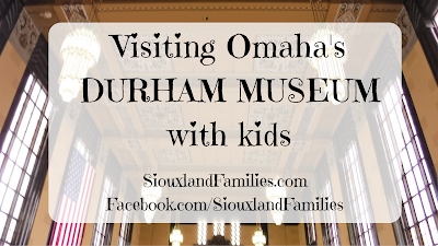 "in background, art deco style grand hall of Omaha's Union Station, in foreground ""visiting Omaha's Durham Museum with kids"""