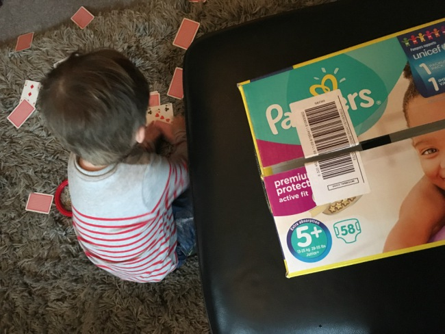 our-weekly-update-19-feb-toddler-picking-up-playing-cards
