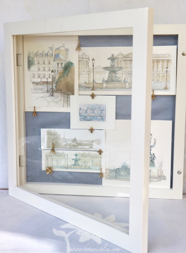 Blue silk fabric elevates a bland white shadowbox into a classic color combination of blue and white