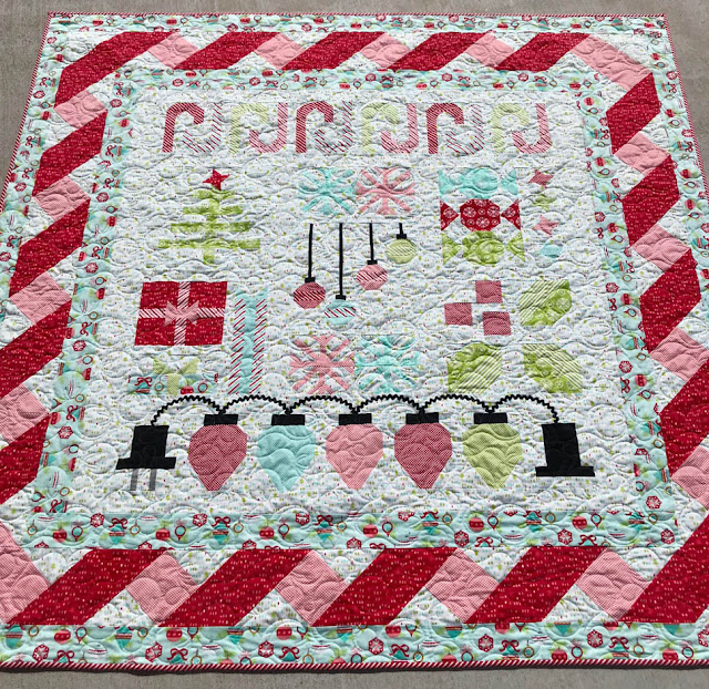A Scrappy Happy Holidays Flannel Quilt Designed, Pieced & Quilted by Thistle Thicket Studio. www.thistlethicketstudio.com