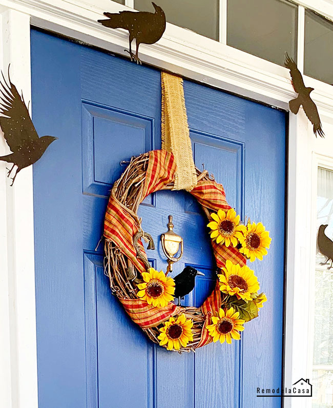 Halloween front porch with blue door and black crows