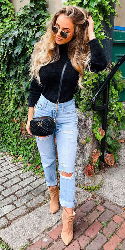 Winter is a great time to step up your personal style. See these 24 Trendy Winter Fashion Ideas for Not So Cold Days. Winter Outfit Ideas for Women via higiggle.com | casual winter look with black sweater & jeans | #winter #fashion #sweater