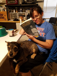 Tracy reading with her dog, Rory
