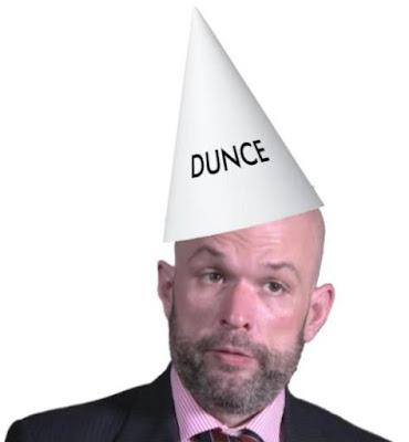 Kevin D. Williamson in a dunce hat