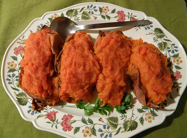 Platter of 4 Pineapple Stuffed Sweet Potatoes garnished with Parsley